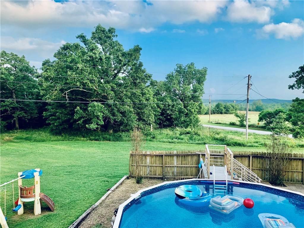 18. Single Family Homes for Sale at 304 Hale Road Elkins, Arkansas 72727 United States